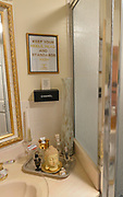"""A corner above the sink in the guest bathroom. Photo taken on January 8, 2019 for """"At Home"""" feature on Sandy Stolberg, who uses dollar store finds as part of the decorations in her Belleville, IL condo.<br /> Photo by Tim Vizer"""