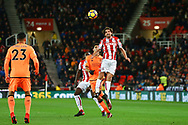 Joe Allen of Stoke City jumps above Dominic Solanke of Liverpool to head the ball. Premier league match, Stoke City v Liverpool at the Bet365 Stadium in Stoke on Trent, Staffs on Wednesday 29th November 2017.<br /> pic by Chris Stading, Andrew Orchard sports photography.
