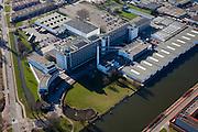Nederland, Zuid-Holland, Rotterdam, 20-03-2009; Bedrijventerrein Spaanse Polder, met Delfhavensche Schie en de voormalige van Nellefabriek voor tabak, koffie en thee. De voormalige fabriek is een Rijksmonument en een voorbeeld van 'Het Nieuwe Bouwen'. Het gebouw van architect Van der Vlugt is nu in gebruik als 'Ontwerpfabriek' en wordt gebruikt voor kantoren, evenementen en dergelijke. . Air view on the Business park, with the old Van Nelle factory, a industrial monument..Swart collectie, luchtfoto (toeslag); Swart Collection, aerial photo (additional fee required).foto Siebe Swart / photo Siebe Swart