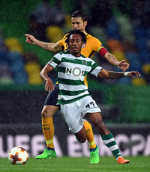 LISBON, April 13, 2018  Gelson Martins (F) of Sporting vies with Gabi of Atletico during the Europa League quarterfinal second leg soccer match between Sporting CP and Club Atletico de Madrid at the Jose Alvalade stadium in Lisbon, Portugal, on April 12, 2018. Sporting won 1-0 but was eliminated by a 1-2 on aggregate. (Credit Image: © Zhang Liyun/Xinhua via ZUMA Wire)