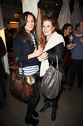 Left to right, ZOE SHEPHERD and EMMA BURRETT at reception to raise funds for a Ugandan School Project supported by the Henry van Straubenzee Memorial Fund held at Few & Far, 242 Brompton Road, London SW3 on 11th February 2010.