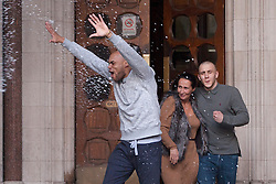 © licensed to London News Pictures. London, UK 29/11/2012. John Kafunda (left) and Reece Donovan (right) who were jailed for robbing a Malaysian student as they pretended to help him during the riots in London, celebrating outside the Royal Courts of Justice after being released on 29/11/12.  Photo credit: Tolga Akmen/LNP