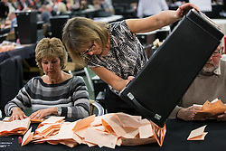 © Licensed to London News Pictures . 07/05/2015 . Doncaster , UK . Ballots being sorted and counted . The count for the 2015 General Election in Labour Party leader Ed Miliband's constituency of Doncaster North , at Doncaster Racecourse . Photo credit : Joel Goodman/LNP