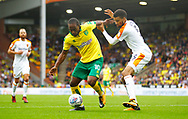 Norwich City's Cameron Jerome and Hull City's Michael Hector during the EFL Sky Bet Championship match between Norwich City and Hull City at Carrow Road, Norwich, England on 14 October 2017. Photo by John Marsh.