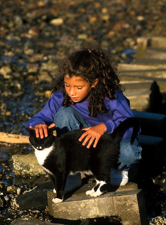Girl petting a cat.