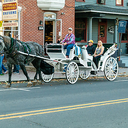 Gettysburg, PA USA - October 25, 2014: A horse-drawn carriage parked on the street on a late autumn afternoon in the town.