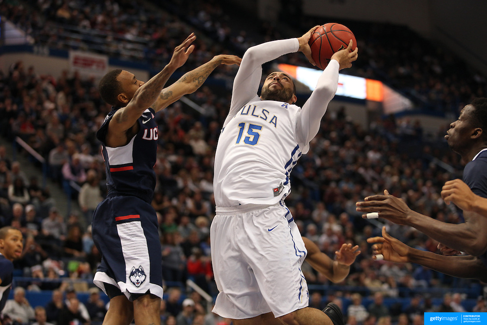 Marquel Curtis, Tulsa, drives to the basket defended by Ryan Boatright, UConn, during the UConn Huskies Vs Tulsa Semi Final game at the American Athletic Conference Men's College Basketball Championships 2015 at the XL Center, Hartford, Connecticut, USA. 14th March 2015. Photo Tim Clayton