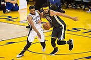 San Antonio Spurs forward Rudy Gay (22) and Golden State Warriors center JaVale McGee (1) battle for a loose ball during Game 2 of the Western Conference Quarterfinals at Oracle Arena in Oakland, Calif., on April 16, 2018. (Stan Olszewski/Special to S.F. Examiner)