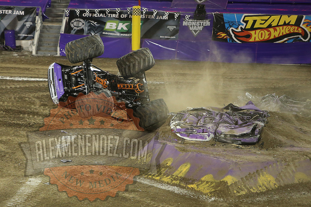 Bad News driven by Brandon Derrow is seen flipping onto its roof during the Monster Jam big truck event at the Citrus Bowl in Orlando, Florida on Saturday, January 25, 2014. (AP Photo/Alex Menendez)