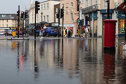 © Licensed to London News Pictures. 25/07/2021. London, UK. A section of flooded road in Greenwich Town Centre following a thunderstorm. An amber weather warning for thunderstorms is in place in parts of London and the South East . Photo credit: George Cracknell Wright/LNP