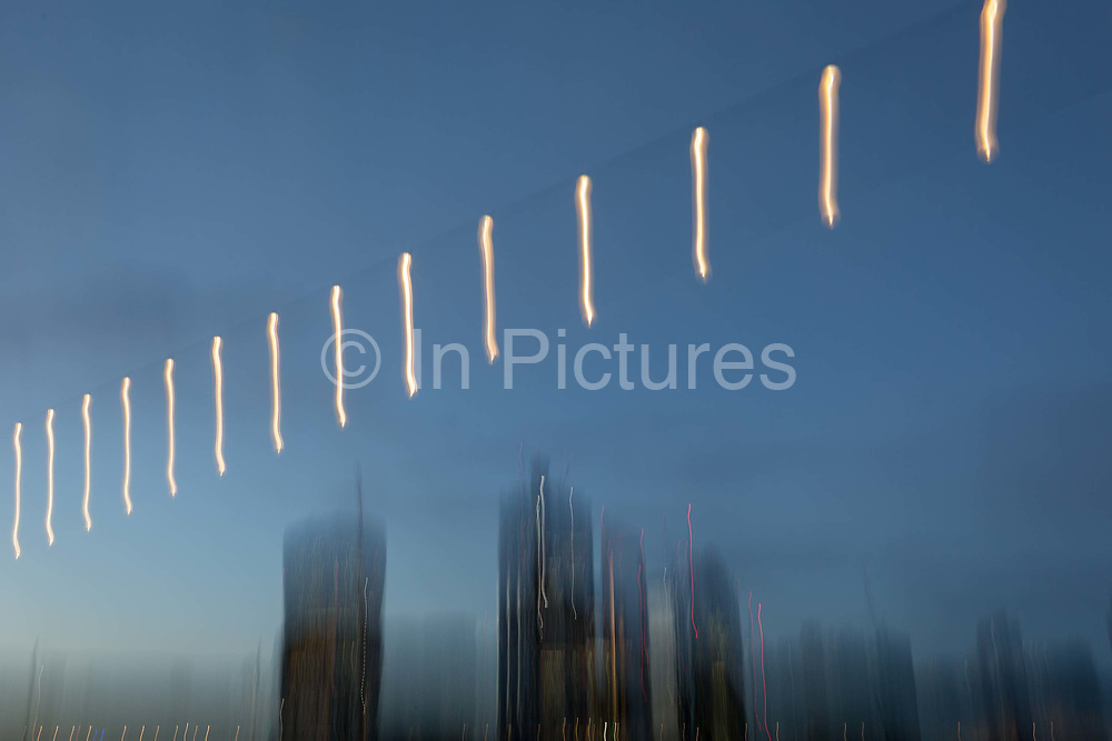 Blurred overhead lights on the Southbank and the skyline of the City of London - the capitals financial district aka The Square Mile, on 29th October 2018, in London, England.