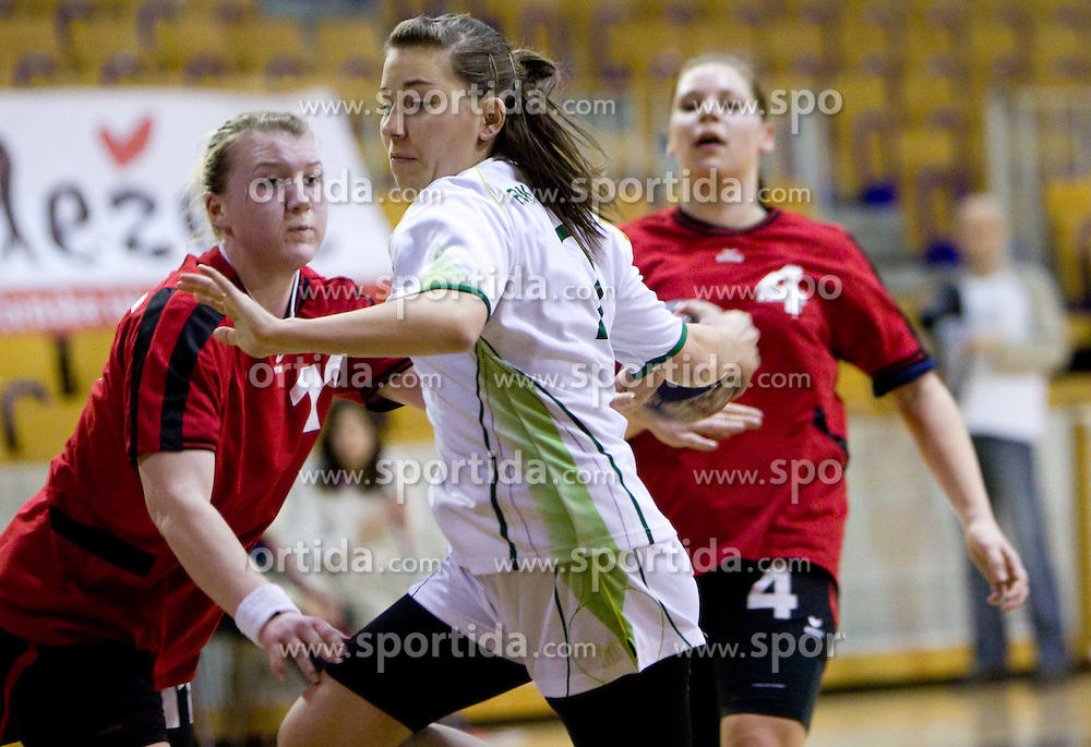 Margerita Kocjancic of Piran vs Tina Vardijan of Olimpija during handball match of 1st Slovenian women league Liga Z dezele between RK Olimpija Ljubljana and RK Piran on January 27, 2011 in Arena Tivoli, Ljubljana, Slovenia.  (Photo By Vid Ponikvar / Sportida.com)