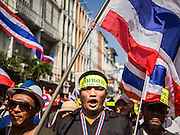 05 JANUARY 2014 - BANGKOK, THAILAND: Anti-government marchers walk through Chinatown in Bangkok Sunday. Suthep Thaugsuband, leader of the anti-government protests in Bangkok, led the protestors on a march through the Chinatown district of Bangkok. Tens of thousands of people waving Thai flags and blowing whistles gridlocked what was already one of the most congested parts of the city. The march was intended to be a warm up to their plan by protestors to completely shut down Bangkok starting Jan. 13.     PHOTO BY JACK KURTZ