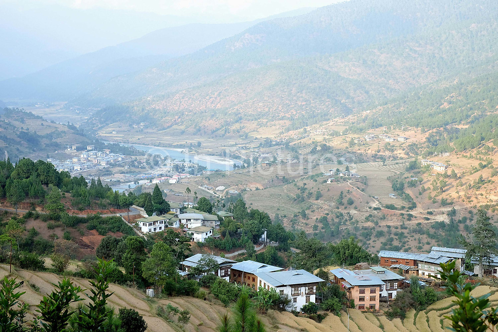 A view of Punakha valley in Western Bhutan. The Punakha valley sits at the junction of the Mo Chhu (Mother River) and Pho Chhu (Father River) and was Bhutan's capital for over 300 years.