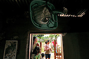 A family stands in front of their home in a poor section of Guaimaca, Honduras.  Above the door a baby seat.  Honduras is considered the third poorest country in the Western Hemisphere (Haiti, Nicaragua). With over 50% of the population living below the poverty line and 28% unemployed, Hondurans frequently turn to illegal immigration as a solution to their desperate situation. The Department of Homeland Security has noted an 95% increase in illegal immigrants coming from Honduras between 2000 and 2009, the largest increase of any country.