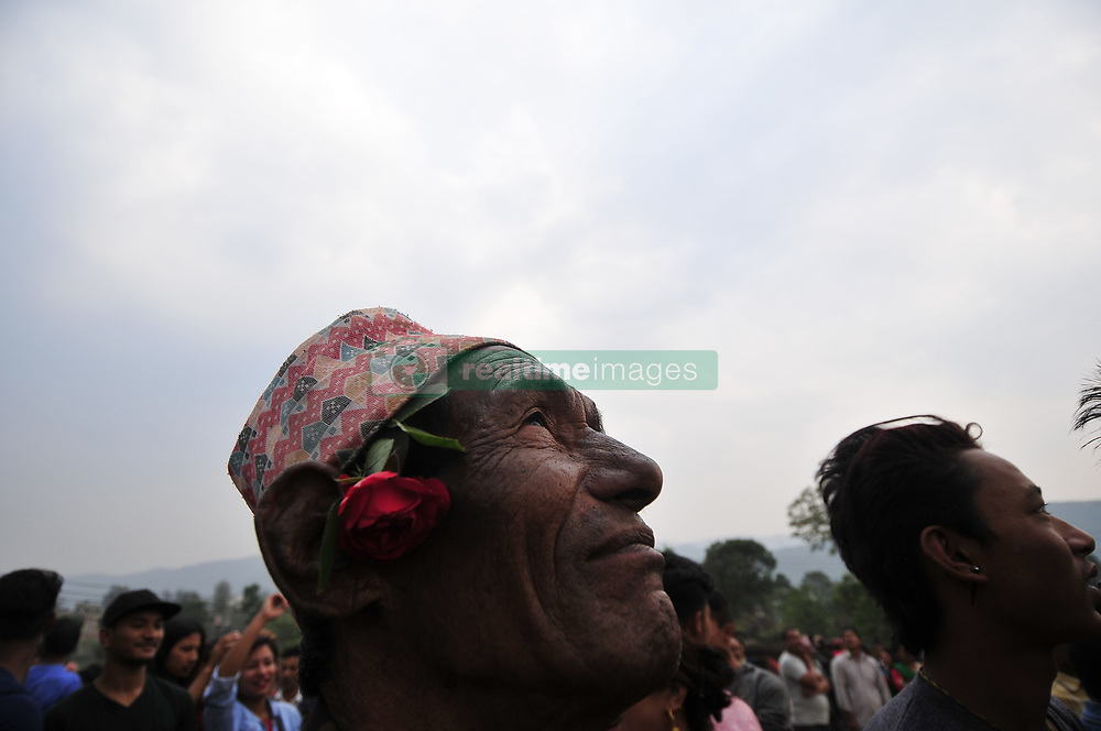 April 14, 2017 - Kathmandu, NP, Nepal - A Portrait of an old man observe the pull down 'Linga' a wodden pole during the celebration of Bisket Jatra Festival at Bhaktapur, Nepal on Friday, April 14, 2017. The Bisket Jatra festival is a week long festival celebrated at Bhaktapur during Nepalese New year celebration. (Credit Image: © Narayan Maharjan/Pacific Press via ZUMA Wire)