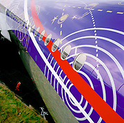A detail of a Boeing 777 airliner during the bi-annual aerospace industry expo at the Farnborough airshow in southern England. The plane's colour scheme across its fuselage and cabin has been carefully chosen and applied by Boeing whose aircraft this is as it makes a European press and PR tour to help foreign airlines make their choice of an American manufacturer.