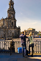 Tourists looking from the Bruhl's Terrace to the Hofkirche and Semper Opera House, Dresden, Saxony, Germany