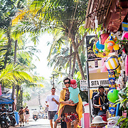 The market street of village Agonda in the south Indian state of Goa. Improvised shacks sell everything from handmade jewellery and Ayurvedic herbs, The market street in the village of Aginda, to cold drinks and sun cream.