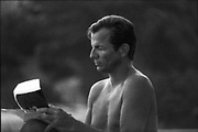 Silver gelatine of PB writing on the beach, in Cassis, 1984