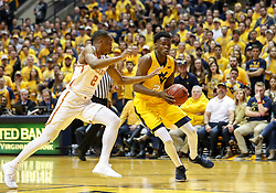 Jan 20, 2018; Morgantown, WV, USA; West Virginia Mountaineers forward Wesley Harris (21) drives to the basket during the second half against the Texas Longhorns at WVU Coliseum. Mandatory Credit: Ben Queen-USA TODAY Sports