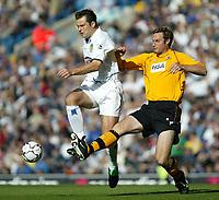 Photo. Andrew Unwin<br /> Leeds United v Blackburn Rovers, Barclaycard Premier league, Elland Road, Leeds 04/10/2003.<br /> Blackburn's Nils-Eric Johansson (r) tries to tackle Leeds' Mark Viduka (r).