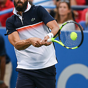 BENOIT PAIRE hits a backhand at the Rock Creek Tennis Center.