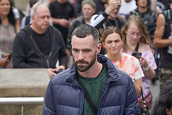 © Licensed to London News Pictures. 14/08/2021. Manchester,UK. Sean Ward from the film coronation streets he takes part in a protest against vaccine passport in Central Manchester. Photo credit: Ioannis Alexopoulos/LNP