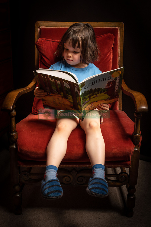 A child reads a copy of 'The Gruffalo', at home in London.  Picture date: Sunday May 10, 2020. Photo credit should read: Matt Crossick/Empics