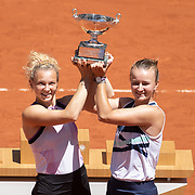 PARIS, FRANCE June 13.  Barbora Krejcikova and Katerina Siniakova of the Czech Republic with the winners trophy after their victory against Bethanie Mattek-Sands of the United States and Iga Swiatek of Poland  on Court Philippe-Chatrier during the final of the doubles competition at the 2021 French Open Tennis Tournament at Roland Garros on June 13th 2021 in Paris, France. (Photo by Tim Clayton/Corbis via Getty Images)