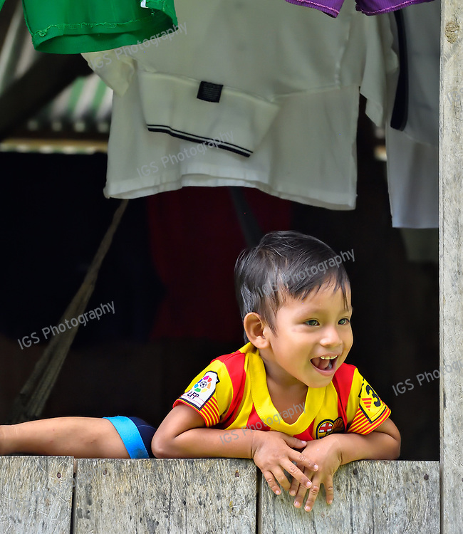 Indigenous Indian boy in the village of  Indiana on the Amazon River in Peru
