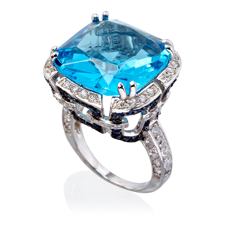 Picture of a big aquamarine ring, set in a diamond set crown. This piece of jewelry was photographed for David& MIna.
