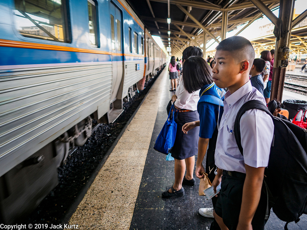02 JANUARY 2019 - BANGKOK, THAILAND:      People wait to board a train going to Lopburi in Hua Lamphong Train Station in Bangkok. The train and bus stations in Bangkok were crowded Wednesday with people going home after the long New Year's weekend.     PHOTO BY JACK KURTZ