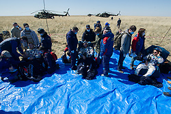 Expedition 62 crew members Andrew Morgan of NASA, left, Oleg Skripochka of Roscosmos, center, and Jessica Meir of NASA sit in chairs outside the Soyuz MS-15 spacecraft after they landed in a remote area near the town of Zhezkazgan, Kazakhstan on Friday, April 17, 2020. Meir and Skripochka returned after 205 days in space, and Morgan after 272 days in space. All three served as Expedition 60-61-62 crew members onboard the International Space Station.<br /> <br /> Where: Zhezkazgan, Kazakhstan<br /> When: 17 Apr 2020<br /> Credit: NASA/GCTC/Andrey Shelepin/Cover Images<br /> <br /> **Editorial use only**