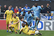Coventry City forward (on loan from Wolverhampton Wanderers)Bright Enobakhare (24) skips a tackle from Bristol Rovers midfielder Abu Ogogo (25) during the EFL Sky Bet League 1 match between Coventry City and Bristol Rovers at the Ricoh Arena, Coventry, England on 7 April 2019.