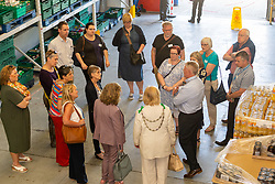 FareShare Kent Operations Manager Paul Underdown explains the workings of the warehouse to guests at the opening of FareShare's relocated warehouse in Ashford, Kent. Ashford, Kent, May 23 2019.