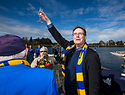 Clint Hamilton raises his glass during the christening of the Howie Campbell prior to the annual Brown Cup regatta between the University of Victoria and University of British Columbia at the Gorge Waterway in Victoria, British Columbia Canada on March 25, 2017.