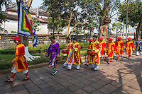 Changing of the Guards performed by artists of Hue Traditional Royal Theatre of Arts, including the mandarins and soldiers walking from Hien Nhơn gate to Ngo Mon gate at Hue Citadel.