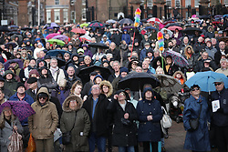 © Licensed to London News Pictures. 28/03/2018. Liverpool, UK. A crowd watches the service on a big screen outside Liverpool Cathedral . The funeral of comedian and performer Sir Ken Dodd , who died on 11th March 2018 at the age of 90 . Photo credit: Joel Goodman/LNP