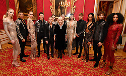 Julien Macdonald and the Duchess of Cornwall (centre) stand with some of his catwalk models at the Julien Macdonald Fashion Show Reception at Lancaster House in London, which is supporting the National Osteoporosis Society charity.