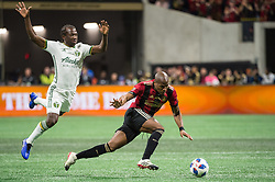 December 8, 2018 - Atlanta, Georgia, United States - Atlanta United midfielder DARLINGTON NAGBE (6) escapes a tackle by Portland Timbers forward ANDY POLO (11) during the MLS Cup at Mercedes-Benz Stadium in Atlanta, Georgia.  Atlanta United defeats Portland Timbers 2-0 (Credit Image: © Mark Smith/ZUMA Wire)
