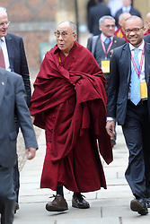 The Dalai Lama visits Cambridge to attend a press conference hosted by Global Scholars Symposium at the Divinity School of St Johns College. He is pictured walking through St Johns College before the conference., Cambridge, UK, Friday April 19,  2013, Photo by: Matthew Power / i-Images
