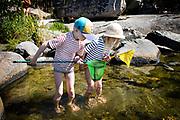 Starno, Sweden, 6 August 2015, Children fishing in the Baltic sea.