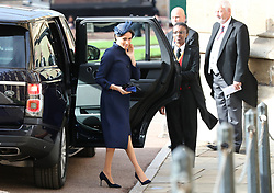 The Duchess of Sussex arrives ahead of the wedding of Princess Eugenie to Jack Brooksbank at St George's Chapel in Windsor Castle