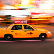 Taxi cab and bright billboards in Times Square in New York City, New York, USA