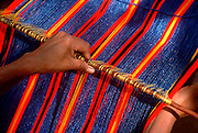 MEXICO, CRAFTS Zapotec Indian women weaving at the market, Oaxaca