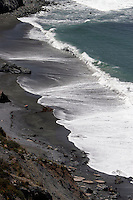 4 August 2006: Jade Cove black sand beach with surf and rocks along Highway 1 through central California along the coast of Big Sur.