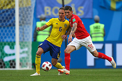 July 3, 2018 - Saint Petersburg, Russia - Ludwig Augustinsson (L) of the Sweden national football team and Steven Zuber of the Switzerland national football team vie for the ball during the 2018 FIFA World Cup match, Round of 16 between Sweden and Switzerland at Saint Petersburg Stadium on July 03, 2018 in St. Petersburg, Russia. (Credit Image: © Igor Russak/NurPhoto via ZUMA Press)