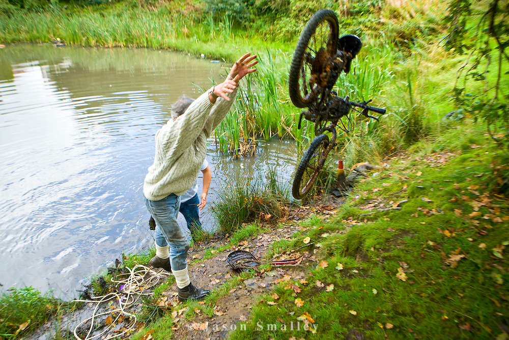 removing a bicycle from a pond