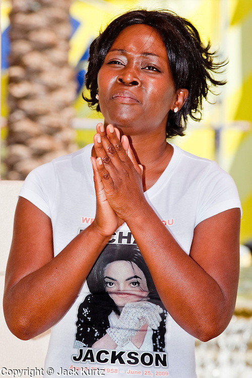 Jul 7, 2009 -- GLENDALE, AZ: SHALOMA GRAY, from Glendale, AZ, sings a Michael Jackson song during a memorial service for the King of Pop in Glendale, AZ, Tuesday. About 35 people came to Westgate Center, a shopping and dining complex in Glendale, a suburb of Phoenix, AZ, to watch the memorial service for Michael Jackson. The service was simulcast live from the Staples Center in Los Angeles on jumbotrons around the complex. Photo by Jack Kurtz